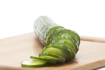 sliced cucumber on board