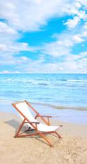 An empty chair on a sandy beach