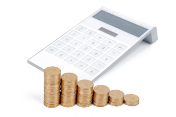 Coins with calculator on white background