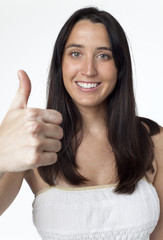 Smiling woman makes thumbs-up gesture