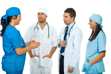 Doctor having conversation with her team