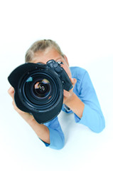 Girl with a camera big lens.