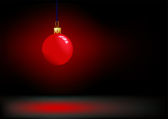 Red christmas ball in darkness