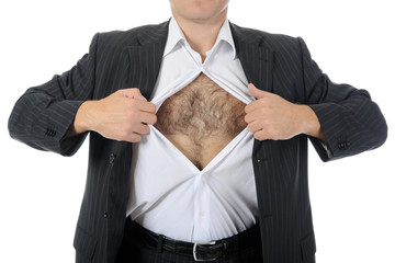 businessman tears open his shirt
