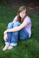sad teen girl sitting