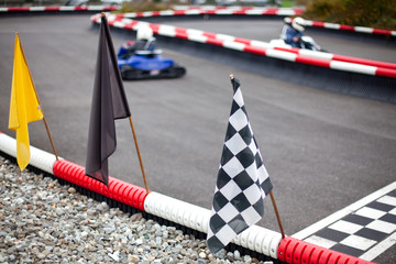 flags and cars on carting carting