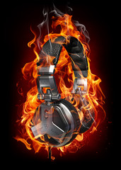 Poster de jardin Flamme Burning headphones