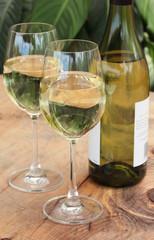 Glasses & Bottle of White Wine on Table