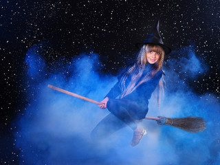 Witch flying on broomstick.