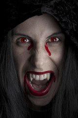 Cloaked female vampire up close.