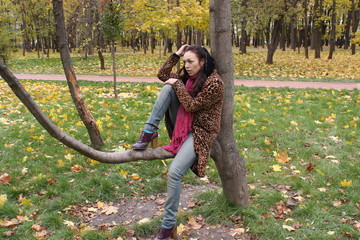Woman is sitting on the tree