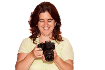 Woman looking at the pictures taken on a professional camera
