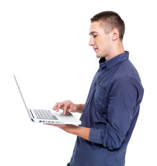 man typing on the laptop - profile portrait