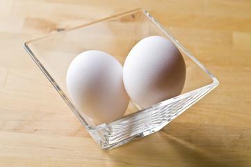 Two raw fresh white eggs in bowl
