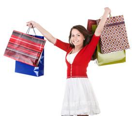 Girl holding group shopping bag. Isolated.