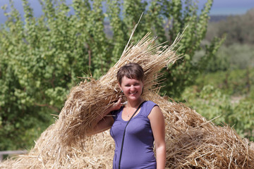 Woman holds sheaf of wheat