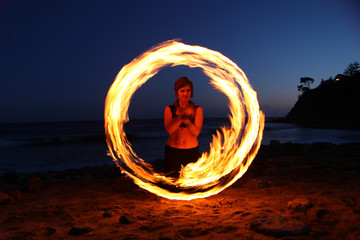 Fire Dance Along the Beach in the Dark