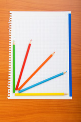 Binder and pencils isolated on the  background