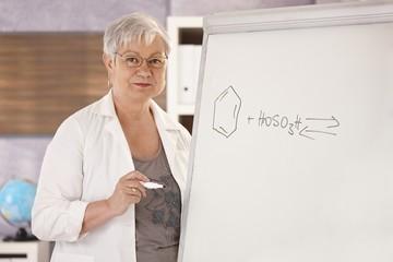 Senior teacher teaching chemistry