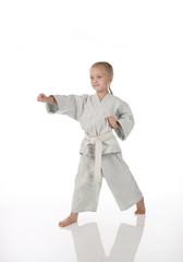 girl - karateka in a kimono on a white background