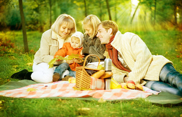Happy Family in autumn park.Picnic