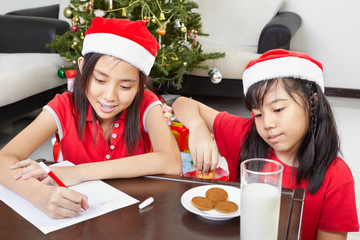 Kids busy preparing letter to Santa