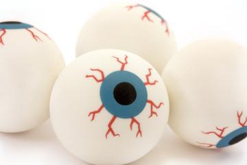 background of rubber toy eyeballs isolated on white