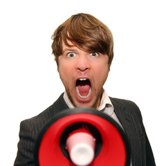 businessman shouting into bullhorn isolated on white