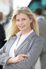 Blond businesswoman with arms crossed