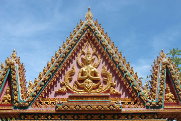 Buddhist art on gable of archway of temple