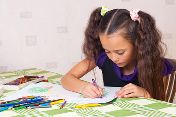 Girl drawing with crayons