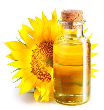 Bottle of sunflower oil with flower.