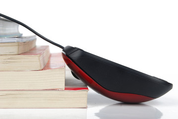 Mouse with books on white background