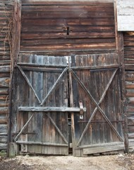 old wooden gate in the rural barn.