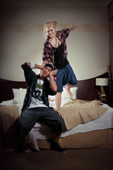 Young couple playing in hotel
