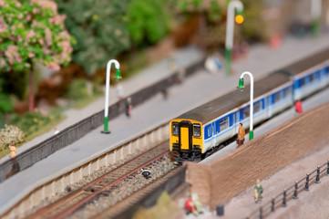 miniature model commuter train in a station