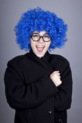 Funny blue-hair girl in glasses and black coat.