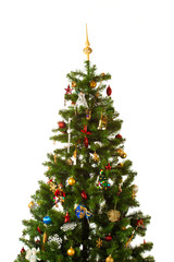 Christmas-tree with multitude of decorations isolated on white
