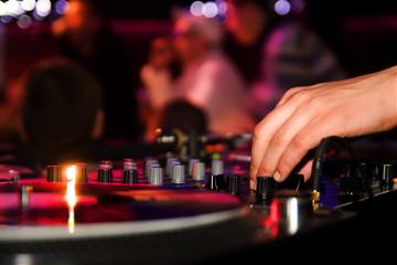 DJ playing vinyl on turntable