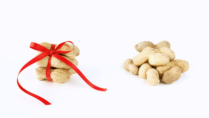 peanuts tied with a bow and a heap  of peanuts