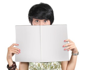 shot of young girl holding a blank magazine