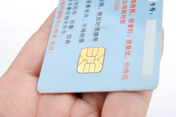 Credit card in hand on white background