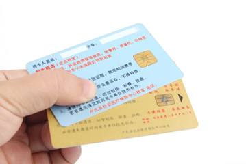 Credit cards in hand on white background