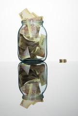 Glass jar full of hundreds of grivnas
