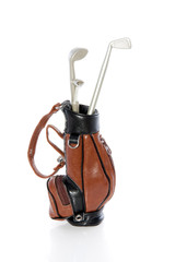 golf equipment in a leather bag isolated on white background