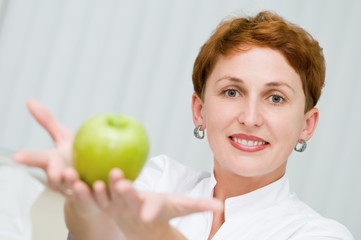 smiley dentist with apple