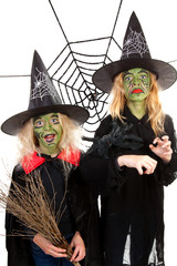 Scary green witches for Halloween over white background