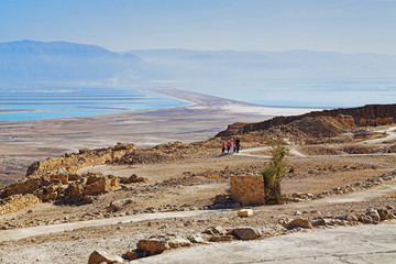 Ruins of fortress Masada and view on the Dead Sea, Israel