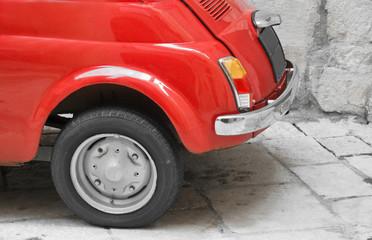 Papiers peints Rouge, noir, blanc Close up of a back red vintage car.