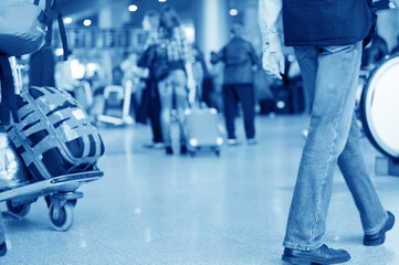 Blurred advancing people through airport installations
